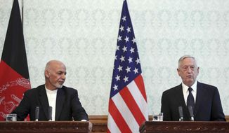 U.S. Defense Secretary Jim Mattis, right, speaks during a press conference with Afghan President Ashraf Ghani, left, and NATO Secretary General Jens Stoltenberg, at the presidential palace in Kabul, Afghanistan, Wednesday, Sept. 27, 2017. The spokesman for the Afghan Interior Ministry said several civilians have been wounded in a rocket attack at Kabul's international airport as Mattis and Stoltenberg are in Kabul. (AP Photo/Rahmat Gul)