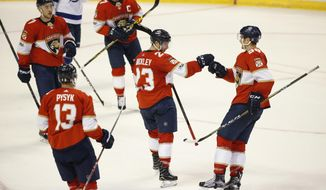 Florida Panthers center Connor Brickley, center, is congratulated by teammates after he scored a goal during the third period of an NHL preseason hockey game against the Tampa Bay Lightning, Tuesday, Sept. 26, 2017, in Sunrise, Fla. The Panthers defeated the Lightning, 4-2. (AP Photo/Wilfredo Lee),