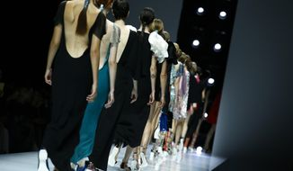 Models wear creations for Lanvin Spring-Summer 2018 ready-to-wear fashion collection presented Wednesday, Sept. 27, 2017 in Paris. (AP Photo/Francois Mori)