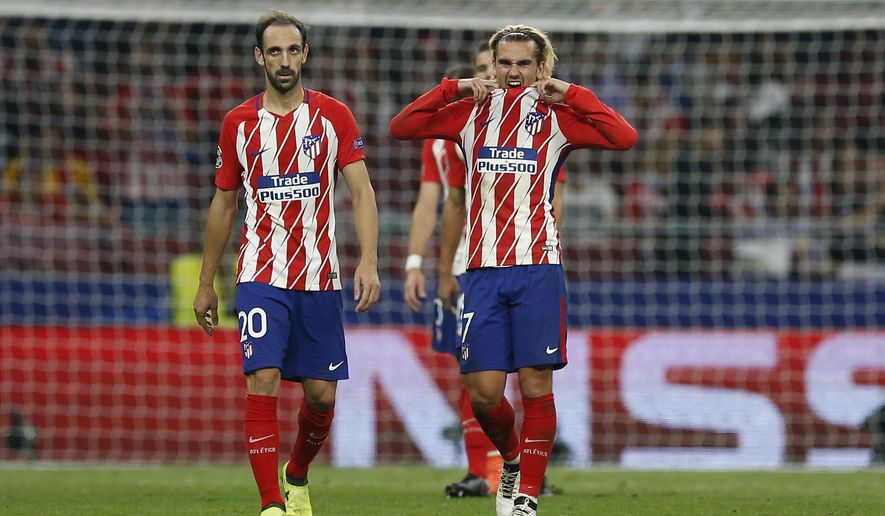 Atletico's Antoine Griezmann, right, and his teammate Juanfran react during a Group C Champions League soccer match between Atletico Madrid and Chelsea at the Wanda Metropolitano stadium in Madrid, Spain, Wednesday Sept. 27, 2017. Chelsea won 2-1.(AP Photo/Paul White)