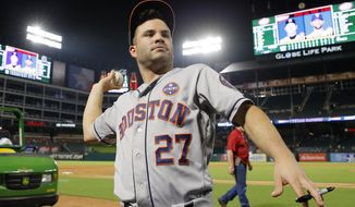 Houston Astros second baseman Jose Altuve (27) throws a ball back to a fan after signing it after their baseball game against the Texas Rangers on Tuesday, Sept. 26, 2017, in Arlington, Texas. The Astros won 14-3. (AP Photo/Tony Gutierrez)