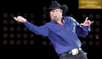 "FILE - In this July 8, 2016, file photo, Garth Brooks sings ""Ain't Going Down"" for his opening song during a performance at Yankee Stadium in New York. Brooks announced on Sept. 27, 2017, a five-part autobiography. The first book will be released in November. (AP Photo/Julie Jacobson, File)"