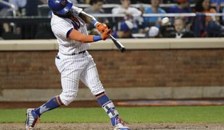New York Mets' Jose Reyes hits an RBI double during the seventh inning of a baseball game against the Atlanta Braves on Wednesday, Sept. 27, 2017, in New York. (AP Photo/Frank Franklin II)