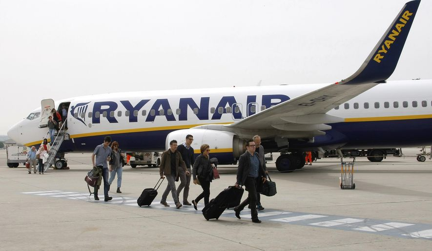 FILE  - In this Wednesday, May 13, 2015 file photo, passengers disembark a Ryanair plane, at the Marseille Provence airport, in Marignane, southern France.  Budget airline Ryanair is reducing its fleet and cancelling thousands of more flights as it struggles to overcome a pilot scheduling crisis. (AP Photo/Claude Paris, FIle)