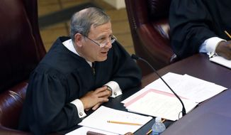 U.S. Supreme Court Chief Justice John Roberts questions third year law students from Mississippi College School of Law and the University of Mississippi School of Law, in a moot court competition in Jackson, Miss., Wednesday, Sept. 27, 2017. (AP Photo/Rogelio V. Solis)