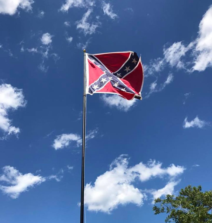 A Confederate battle flag flies on private property adjacent to I-95 in Stafford County, Va., in this Facebook photo from the Confederate heritage group Virginia Flaggers. (Virginia Flaggers/Facebook) [https://www.facebook.com/378823865585630/photos/a.384742074993809.1073741829.378823865585630/1111239069010769/?type=3&theater]