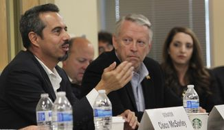 """Rep. Antonio """"Moe"""" Maestas, left, co-chair of the legislative criminal justice reform subcommittee, talks about the challenges of dealing with low-risk offenders during a meeting in Albuquerque, N.M., Wednesday, Sept. 27, 2017. The panel heard from Bernalillo County District Attorney Raul Torrez about rising crime rates in New Mexico's most populous area and the challenges his office has in managing its caseload. (AP Photo/Susan Montoya Bryan)"""