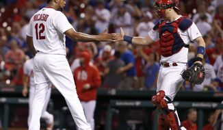 St. Louis Cardinals catcher Carson Kelly, right, and relief pitcher Juan Nicasio celebrate following the team's 8-7 victory over the Chicago Cubs in a baseball game Tuesday, Sept. 26, 2017, in St. Louis. (AP Photo/Jeff Roberson)