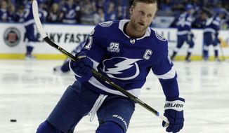 File-This Sept. 22, 2017, file photo shows Tampa Bay Lightning center Steven Stamkos (91) before an NHL preseason hockey game against the Nashville Predators  in Tampa, Fla. (AP Photo/Chris O'Meara, File)