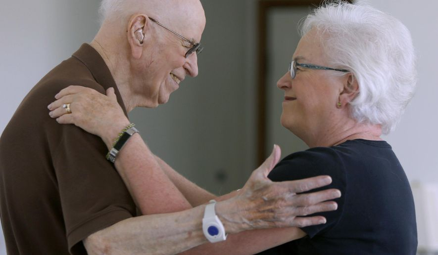 This September 2017 photo shows Robert Levin, 96, of Rochester, Minn., and his daughter, Carolyn McIntosh. Levin is one of the few remaining former scientists connected with the Manhattan Project. The project was focused on building the atomic bomb that was dropped on the Japanese city of Hiroshima in 1945 and marked the end of World War II. (Elizabeth Nida Obert/The Rochester Post-Bulletin via AP)