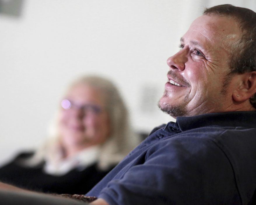 In this Tuesday, Aug. 29, 2017 photo, Casey Sexton, 55, speaks during an interview at his apartment in Madison, Wis. Despite having most of his breasts removed in 2010 as part of gender reassignment surgery, Sexton was diagnosed with breast cancer in 2016. (John Hart/Wisconsin State Journal via AP)