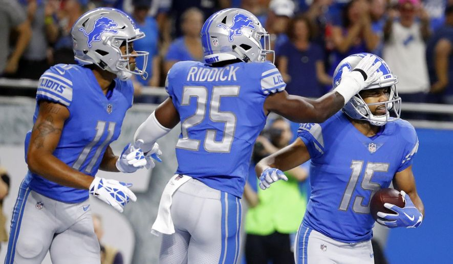 REMOVES REFERENCE TO 11-YARD RUSH. PLAY WAS A PASS RECEPTION - Detroit Lions wide receiver Golden Tate (15) is congratulated by running back Theo Riddick (25) after scoring a touchdown during the second half of an NFL football game against the Atlanta Falcons, Sunday, Sept. 24, 2017, in Detroit. (AP Photo/Rick Osentoski)
