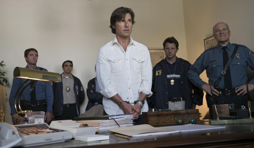 "Tom Cruise stars as Barry Seal in a scene from, ""American Made."" (David James/Universal Pictures via AP) ** FILE **"
