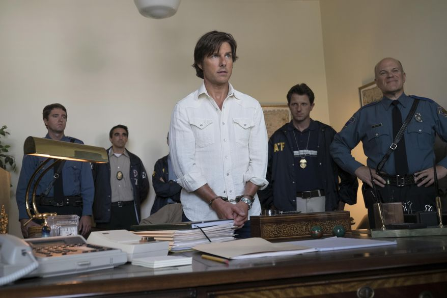 """Tom Cruise stars as Barry Seal in a scene from, """"American Made."""" (David James/Universal Pictures via AP) ** FILE **"""