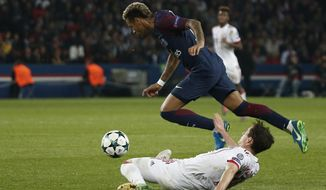 PSG's Neymar, top, is fouled by Bayern's Sebastian Rudy during the Champions League Group B soccer match between Paris Saint-Germain and Bayern Munich in Paris, France, Wednesday, Sept. 27, 2017. (AP Photo/Thibault Camus)
