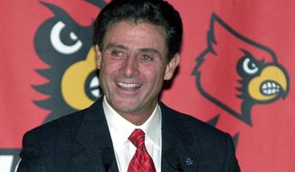 FILE - In this March 21, 2001, file photo, Rick Pitino speaks to a gathering of university officials and supporters following the announcement naming him as the new head basketball coach at the University of Louisville in Louisville, Ky. Louisville announced Wednesday, Sept. 27, 2017, that they have placed basketball coach Rick Pitino and athletic director Tom Jurich on administrative leave amid an FBI probe. (AP Photo/Timothy D. Easley, File)