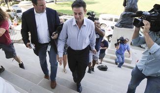 Louisville men's basketball coach Rick Pitino arrives at Grawemeyer Hall for a meeting with the university's interim president Greg Postel, Wednesday, Sept. 27, 2017, in Louisville. Ky. Louisville announced Wednesday that they have placed Pitino and athletic director Tom Jurich on administrative leave amid a federal bribery investigation. (Michael Clevenger/The Courier-Journal via AP)