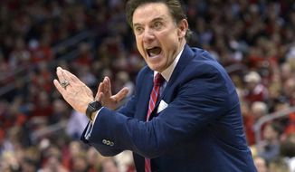 FILE - In this Feb. 17, 2016, file photo, Louisville coach Rick Pitino directs his team during an NCAA college basketball game against Syracuse in Louisville Ky.  Louisville announced Wednesday, Sept. 27, 2017, that they have placed basketball coach Rick Pitino and athletic director Tom Jurich on administrative leave amid an FBI probe. (AP Photo/Timothy D. Easley, File)