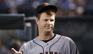 San Francisco Giants pitcher Matt Cain walks through the dugout during the third inning of a baseball game against the Arizona Diamondbacks Wednesday, Sept. 27, 2017, in Phoenix.  San Francisco pitcher Matt Cain says he'll retire after his start at home on Saturday against San Diego. The 32-year-old Cain informed teammates of his decision in a closed meeting before Wednesday's game at Chase Field against the Arizona Diamondbacks.  (AP Photo/Ross D. Franklin) **FILE**