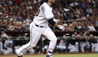 Arizona Diamondbacks' J.D. Martinez watches his grand slam against the San Francisco Giants during the second inning of a baseball game, Tuesday, Sept. 26, 2017, in Phoenix. (AP Photo/Matt York)