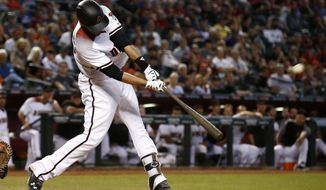 Arizona Diamondbacks' J.D. Martinez connects for a home run against the San Francisco Giants during the ninth inning of a baseball game Wednesday, Sept. 27, 2017, in Phoenix. The Diamondbacks defeated the Giants 4-3. (AP Photo/Ross D. Franklin)
