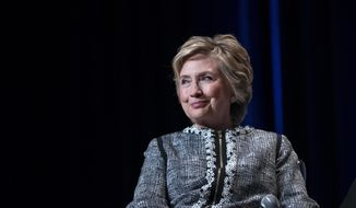 In this June 1, 2017, file photo, former Secretary of State Hillary Clinton pauses while speaking during the Book Expo event in New York. Clinton is helping raise money for the Democratic candidate in Virginia's closely watched race for governor. An invitation obtained by The Associated Press says Clinton is the featured guest at a fundraiser for Lt. Gov. Ralph Northam in New York on Oct. 4. (AP Photo/Craig Ruttle, File)