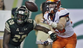FILE - In this Sept. 15, 2017, file photo, Illinois running back Mike Epstein, right, pulls in a 21-yard touchdown pass in front of South Florida safety Devin Abraham during the fourth quarter of an NCAA college football game in Tampa, Fla. When Lovie Smith became coach at Illinois, it was clear that he was taking over a struggling program. In his first year of his rebuilding project Smith relied heavily on upperclassmen, but this time around he's placed a lot of responsibility in the hands of his youths. (AP Photo/Chris O'Meara, File)