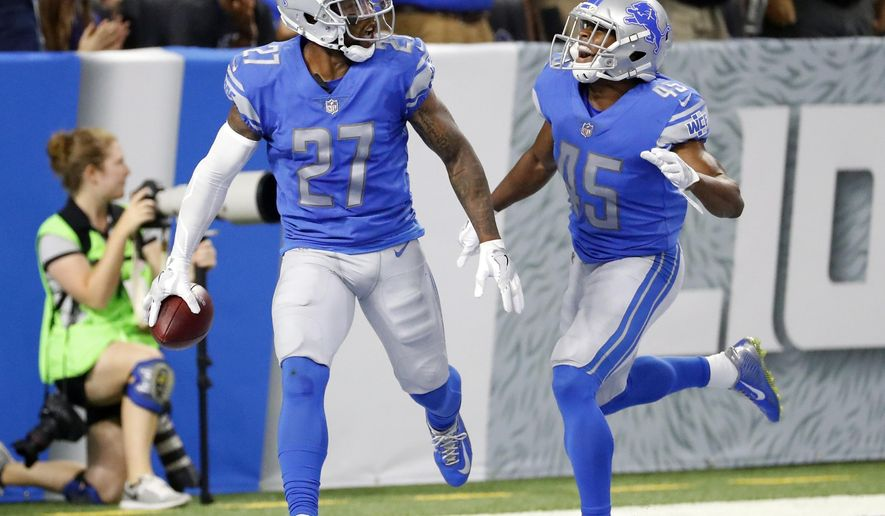 FILE - In this Sunday, Sept. 24, 2017, file photo, Detroit Lions free safety Glover Quin (27) is congratulated by defensive back Charles Washington (45) after returning an interception 37-yards for a touchdown during the first half of an NFL football game against the Atlanta Falcons in Detroit. Long before a replay and a runoff cost the Detroit Lions a chance at a win, their defense was exposed a bit by Atlanta last weekend. (AP Photo/Rick Osentoski, File)