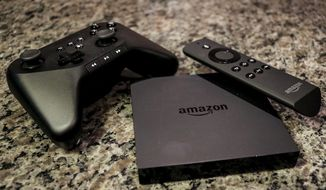FILE - This Sept. 29, 2014, file photo shows the Amazon Fire TV, a product for streaming popular video services, apps and games in high-definition, in Decatur, Ga. Amazon begins its foray into live streaming of NFL games Thursday night, Sept. 28, 2017, when the company will air the game between the Chicago Bears and Green Bay Packers on its Prime Video service as another option to the traditional broadcasts on CBS and the NFL Network. (AP Photo/Ron Harris, File)