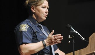 "FILE- In an Oct. 1, 2015 file photo, Michigan State Police Director Col. Kriste Kibbey Etue leads a focus group discussion at Benton Harbor High School, in Benton Harbor, Mich. The 23-member Michigan Legislative Black Caucus is calling for the resignation of Etue for sharing a post on her Facebook page that called NFL players protesting during the national anthem ""degenerates."" The group of lawmakers said Wednesday, Sept. 27, 2017, if Etue doesn't resign, then Gov. Rick Snyder should fire her.  (Don Campbell/The Herald-Palladium via AP, File)"