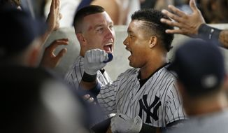 New York Yankees Todd Frazier, left, celebrates with the Yankees' Starlin Castro in the dugout after Castro hit a solo home run in the sixth inning of a baseball game against the Tampa Bay Rays in New York, Wednesday, Sept. 27, 2017. (AP Photo/Kathy Willens)