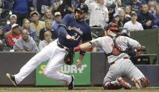 Cincinnati Reds catcher Tucker Barnhart tags out Milwaukee Brewers' Travis Shaw at home during the fourth inning of a baseball game Wednesday, Sept. 27, 2017, in Milwaukee. (AP Photo/Morry Gash)