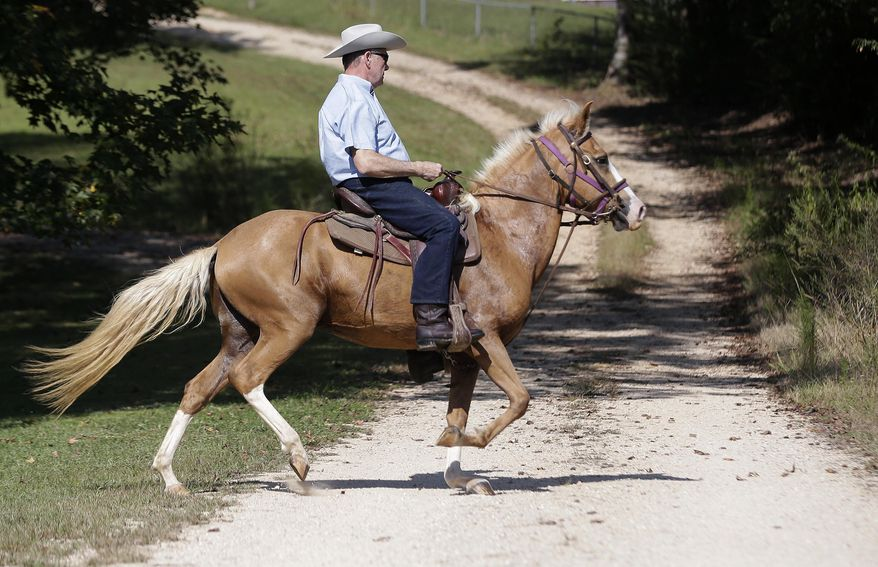This Sept. 26, 2017, file photo, former Alabama Chief Justice and U.S. Senate candidate Roy Moore, rides in on a horse to vote in Gallant, Ala. Moore is the GOP candidate for senate. He will face Democratic nominee Doug Jones. (AP Photo/Brynn Anderson, File)