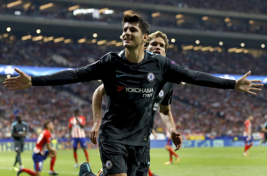 Chelsea's scorer Alvaro Morata, front, and his teammate Marcos Alonso, rear, celebrate their side's first goal during a Champions League group C soccer match between Atletico Madrid and Chelsea at the Wanda Metropolitano stadium in Madrid, Spain, Wednesday, Sept. 27, 2017. (AP Photo/Francisco Seco)