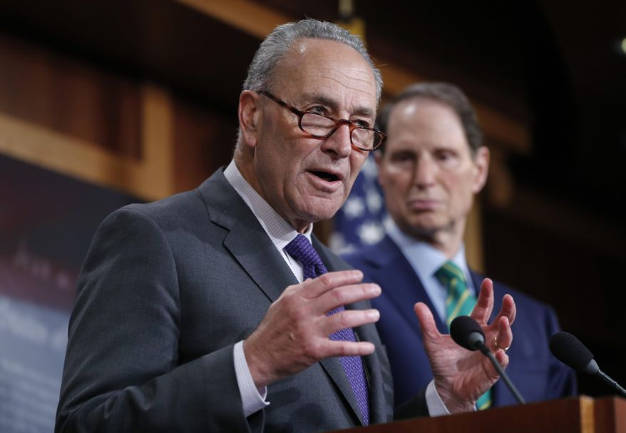 Senate Minority Leader Chuck Schumer of N.Y., and Sen. Ron Wyden, D-Ore., discuss the Republican tax plan during a news conference on Capitol Hill in Washington, Wednesday, Sept. 27, 2017. (AP Photo/Pablo Martinez Monsivais)