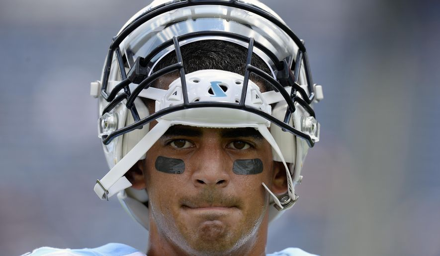 FILE - In this Aug. 19, 2017, file photo, Tennessee Titans quarterback Marcus Mariota warms up before an NFL football preseason game against the Carolina Panthers in Nashville, Tenn. The Titans are tied for first in the NFL giving up only two sacks through the first three weeks, and they've got the league's second-best rushing attack. Their next test comes Sunday in a visit to Houston against J.J. Watt and the Texans. (AP Photo/Mark Zaleski, File)