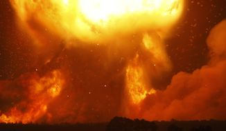 A powerful explosion is seen in the ammunition depot at a military base in Kalynivka, west of Kiev, Ukraine, early Wednesday, Sept. 27, 2017.  Ukrainian officials say they have evacuated more than 30,000 people after a fire and ammunition explosions, at the military base on Tuesday. (AP Photo/Efrem Lukatsky)