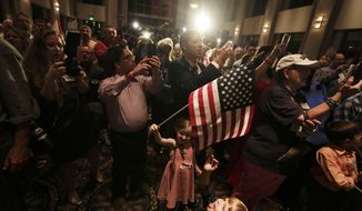Supporters of former Alabama Chief Justice and U.S. Senate candidate Roy Moore wait for him to speak during his election party, Tuesday, Sept. 26, 2017, in Montgomery, Ala. Moore won the Alabama Republican primary runoff for U.S. Senate on Tuesday, defeating an appointed incumbent backed by President Donald Trump and allies of Sen. Mitch McConnell. (AP Photo/Brynn Anderson)