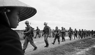 U.S. Marines marching in Danang. March 15, 1965. (Photograph by Associated Press)