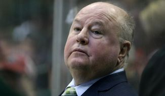 FILE - In this Jan. 14, 2017, file photo, Minnesota Wild head coach Bruce Boudreau watches play against the Dallas Stars in the first period of an NHL hockey game in Dallas. After a sterling regular season in coach  Boudreau's first year, the Minnesota Wild were quickly bounced from the postseason.  (AP Photo/LM Otero, File)