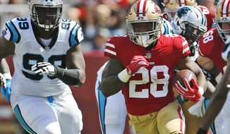 FILE - In this Sept. 10, 2017, file photo, San Francisco 49ers running back Carlos Hyde (28) runs against the Carolina Panthers during the first half of an NFL football game in Santa Clara, Calif. The 49ers face the Arizona Cardinals on Sunday.  (AP Photo/Tony Avelar, File)