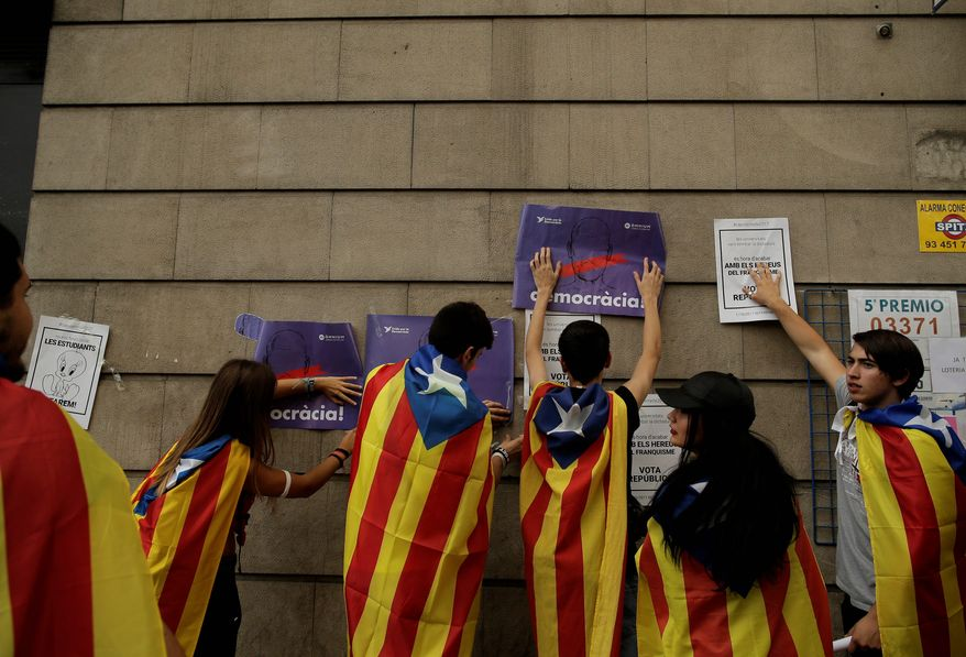 Catalonian separatists say they will go ahead with Sunday's poll to secede from Spain and form their own country, a campaign that has drawn an increasing crackdown from the Spanish government. (Associated Press)