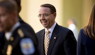 Behind closed doors, Deputy Attorney General Rod Rosenstein met with the House Intelligence Committee to discuss the Justice Department and the anti-Trump dossier. (Associated Press)
