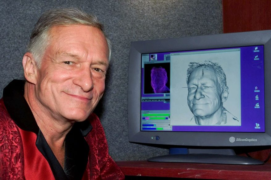 Playboy Enterprises impresario Hugh Hefner poses next to a laser-generated image of his head on a computer screen following a laser scanning session, Tuesday afternoon, Sept. 26, 2000, at the Playboy Mansion in Los Angeles, Calif.  The resulting image will be used to create an exact wax model of his head for a figure at the Hollywood Wax Museum.  The technology, used here for the first time for a wax figure, is the same type used in the creation of high-tech maps and in the manufacture of mechanical parts for jets and automobiles.  The completed figure will be unveiled in Hollywood in November.  (AP Photo/Reed Saxon)
