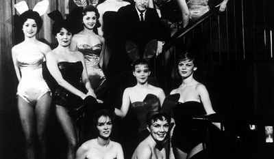 Hugh Hefner, founder and chairman of the Playboy Enterprises, Inc., is pictured amid a group of Bunnies, at the flagship Playboy Club, in Chicago, Ill., circa 1960. (AP Photo)