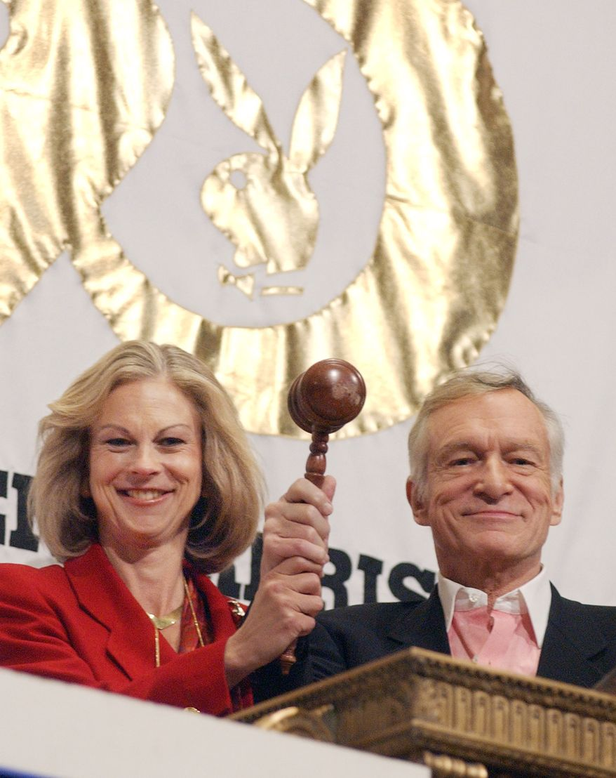 Playboy Chairman & CEO Christie Hefner, and her father Playboy founder Hugh Hefner, hold the gavel that closes trading on the New York Stock Exchange after they rang the closing bell, Wednesday Dec. 3, 2003. Playboy, which listed on the exchange Dec. 20, 1997, is celebrating its 50 anniversary. (AP Photo/Richard Drew)