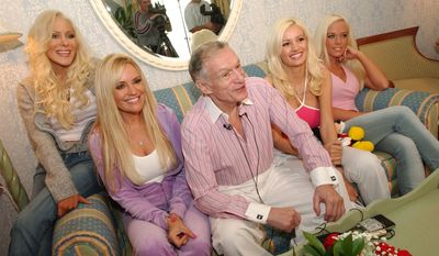 Playboy magazine founder Hugh Hefner, center, answers questions from the media during a news conference at Walt Disney World in Lake Buena Vista, Fla., Thursday, Feb. 3, 2005.  With Hefner, from left, are Cristal Camden, Bridget Marquardt, Holly Madison and Kendra Wilkinson.  The group is visiting Disney's theme parks before heading to Jacksonville, Fla., where Hefner is throwing his legendary Playboy Super Bowl party. (AP Photo/Phelan M. Ebenhack)