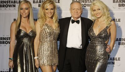 Hugh Hefner with girlfriends Kendra Wilkinson, Bridget Marquardt and Holly Madison arrive at the Barnstable Brown Derby party in Louisville, Ky., Friday, May 2, 2008.  The 134th Kentucky Derby will be held on Saturday, May 3. (AP Photo/Darron Cummings)