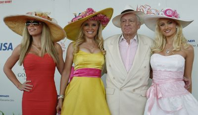Hugh Hefner with girlfriends Kendra Wilkinson, Bridget Marquardt and Holly Madison arrive for the 134th Kentucky Derby Saturday, May 3, 2008, at Churchill Downs in Louisville, Ky.  (AP Photo/David Harpe)