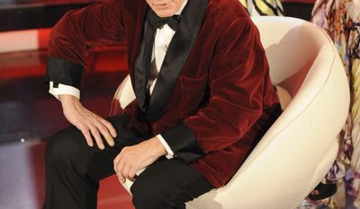 "Hugh Hefner, founder and Chief Creative Officer of Playboy Enterprises, talks during the ""Festival di Sanremo"" Italian song contest, in San Remo, Italy, Friday, Feb. 20, 2009. (AP Photo/Alberto Pellaschiar)"